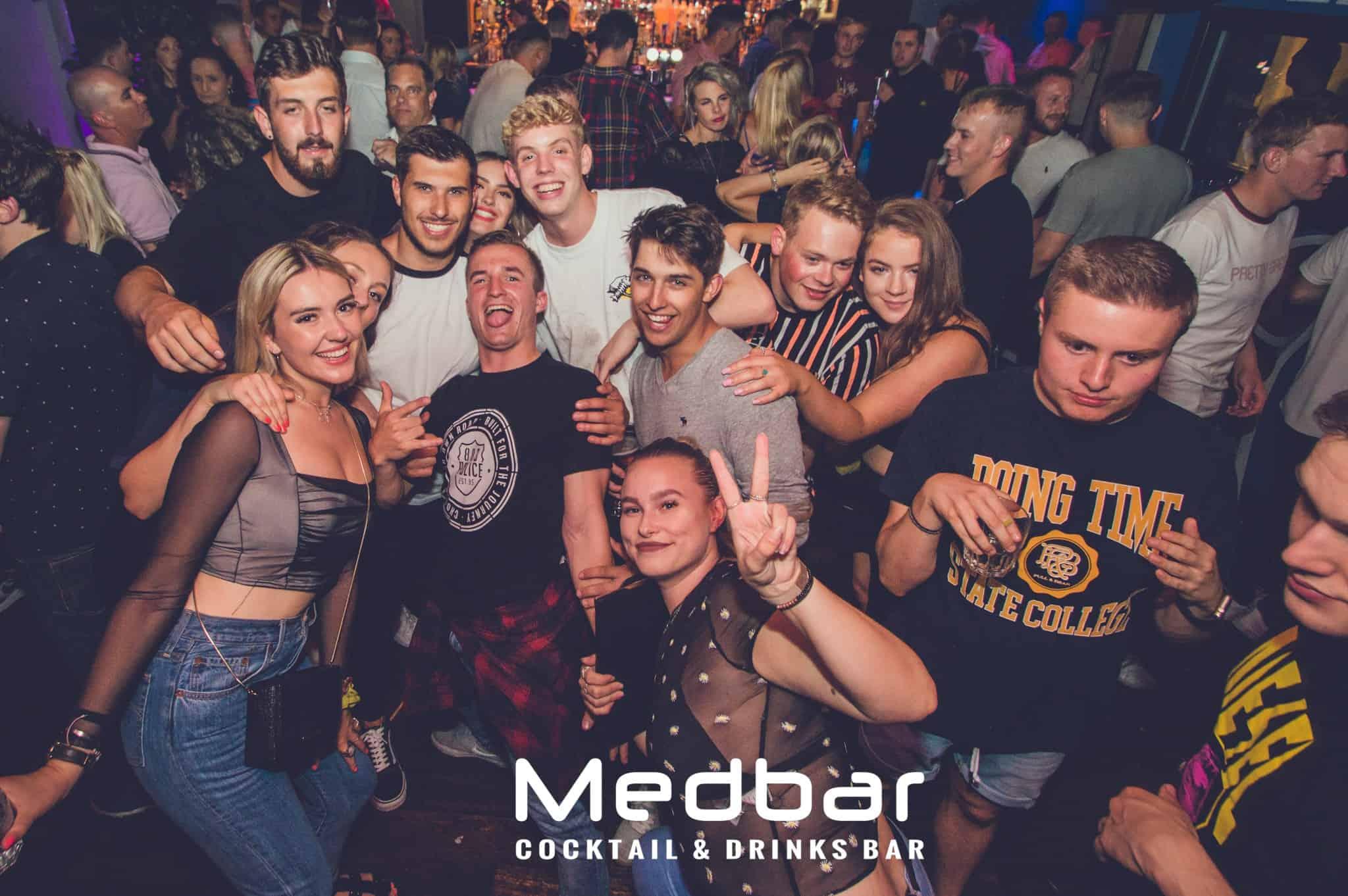 Group of people dancing at nightclub