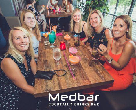 Group of ladies having drinks at restaurant